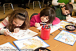 Education Elementary school Grade 2 science special group of students at table coloring geographic maps horizontal