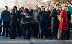 WOODBURY, CT 19 DECEMBER- 121912JS07- Mourners comfort one another outside the Munson-Lovetere Funeral Home in Woodbury on Wednesday during calling hours for Sandy Hook Principal Dawn Hochsprung.. Jim Shannon Republican American
