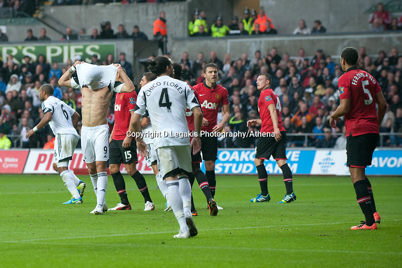 Saturday 17 August 2013<br /> <br /> Pictured: Another mussed Swansea Chance and Michu of Swansea show his fustration by listing his shirt over his head<br /> <br /> Re: Barclays Premier League Swansea City v Manchester United at the Liberty Stadium, Swansea, Wales