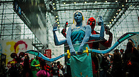 Revellers pose for pictures while they attend the annual event Comic Con at the Javits center in New York.  09.05.2014. Eduardo Munoz Alvarez/VIEWpress