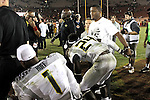 Former Oregon Ducks star Lamichael James joins his friend Ducks running back Kenjon Barner in a prayer after the Ducks 62-51 win over the USC Trojans..Photo by Jaime Valdez