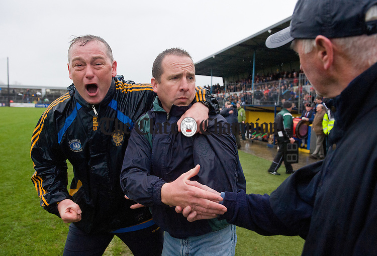 Newmarket selector Kevin Halpin is in the mood for celebrating as team manager Bob Enright concentrates on offering his hand to Joe Mc Grath, the Cratloe manager at the end of the senior county hurling final at Cusack Park. Photograph by John Kelly.