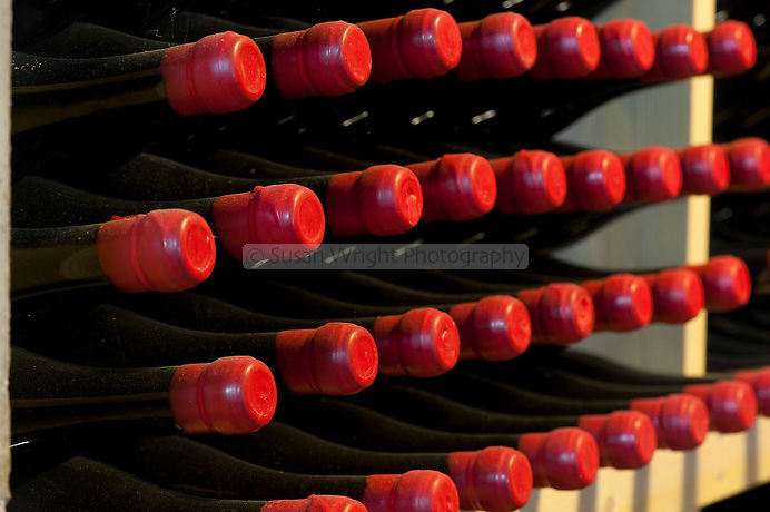 Wax sealed wine bottles in the cantina/cellar of Occhipinti Winery, near Vittoria, Sicily