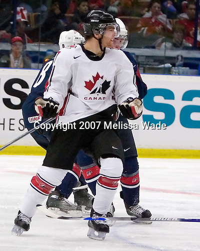 Steve Downie (Queensville, ON - Peterborough Petes) looks for a call as he loses his stick. Team Canada defeated Team USA 2-1 by winning the seventh round of the shootout on Wednesday, January 3, 2007 at Ejendals Arena in Leksand, Sweden.  The result gave Team Canada the opportunity to play for the gold medal and Team USA the opportunity to play for the bronze medal.