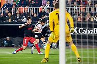 14th February 2020; Mestalla, Valencia, Spain; La Liga Football,Valencia versus Atletico Madrid; Jose Gaya of Valencia CF centers into the box challenged by Santiago Arias of Atletico Madrid