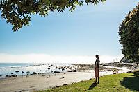 Young woman at Kaikoura beach, Kaikoura, Marlborough Region, South Island, East Coast, New Zealand