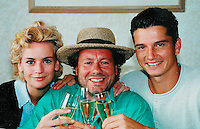 1996, England, Tennis, Wimbledon, Richard Krajicek(r) just won Wimbledon and drinks champagne with his wife Daphne Deckers and photographer Henk Koster