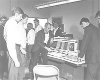 M. L. Pierce demonstrates IBM computer at UTA, 1968