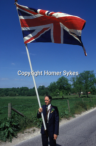 "Union flag is carried at the head of the [Grovely Forest Right] procession. [Wishford Magna], Wiltshire, England ""Oak Apple Day"