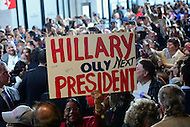 Baltimore, MD - April 10, 2016: A woman holds a sign supporting 2016 Democratic presidential candidate Hilary Clinton speaks during a campaign event at the City Garage in Baltimore, MD, April 10, 2016.  (Photo by Don Baxter/Media Images International)