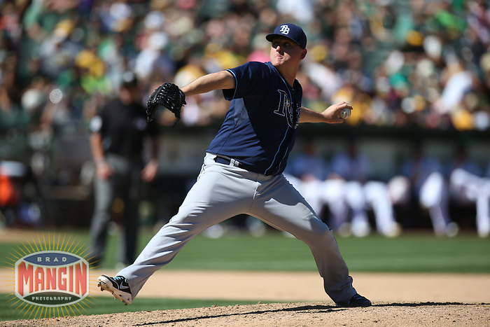 OAKLAND, CA - SEPTEMBER 1:  Jake McGee #57 of the Tampa Bay Rays pitches against the Oakland Athletics during the game at O.co Coliseum on Sunday, September 1, 2013 in Oakland, California. Photo by Brad Mangin