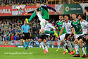 Northern Ireland's Kyle Lafferty launches himself into the air past Germany's  Sandro Wagner and Marvin Plattenhardt during the FIFA World Cup 2018 Qualifying Group C qualifying soccer match between Northern Ireland and Germany at the National Football Stadium at Windsor Park, Belfast, Northern Ireland, 5 Oct 2017. Photo/Paul McErlane