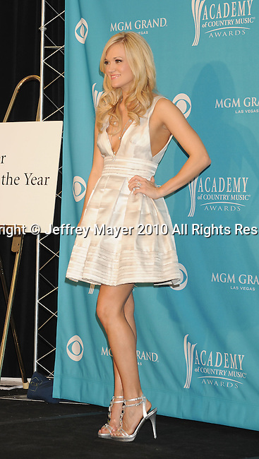 LAS VEGAS, NV. - April 18: Singer Carrie Underwood, winner of Entertainer of the Year Award and the Triple Crown Award poses in the press room during the 45th Annual Academy of Country Music Awards at the MGM Grand Garden Arena on April 18, 2010 in Las Vegas, Nevada.