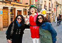 Tourists pose with Toledo figure, Spain