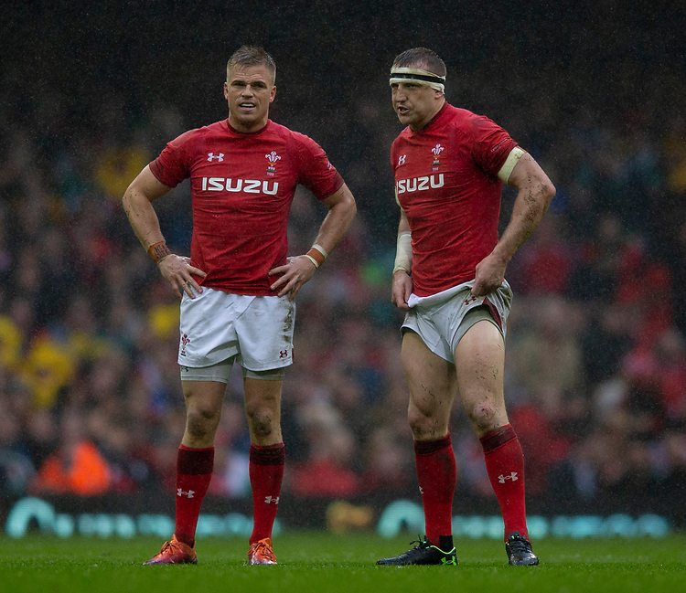 Wales' Gareth Anscombe and Wales' Hadleigh Parkes<br /> <br /> Photographer Bob Bradford/CameraSport<br /> <br /> Guinness Six Nations Championship - Wales v Ireland - Saturday 16th March 2019 - Principality Stadium - Cardiff<br /> <br /> World Copyright © 2019 CameraSport. All rights reserved. 43 Linden Ave. Countesthorpe. Leicester. England. LE8 5PG - Tel: +44 (0) 116 277 4147 - admin@camerasport.com - www.camerasport.com