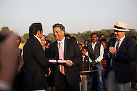 Nik Senapati (center), Managing Director of Argyle Pink Diamonds, presents a gift to Maharaj Narendra Singh (left) of the Jaipur royal family, and the captain of the Royal Jaipur Polo Team after they win a close match for the Argyle Pink Diamond Cup, organised as part of the 2013 Oz Fest in the Rajasthan Polo Club grounds in Jaipur, Rajasthan, India on 10th January 2013. Photo by Suzanne Lee