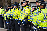 © Joel Goodman - 07973 332324 . 09/12/2010 . London , UK . Rows of police with riot helmets alongside the march route . Students and their supporters demonstrate in Parliament Square in London against government cuts to student support , Educational Maintenance Allowance ( EMA ) and rising university tuition fees . Photo credit : Joel Goodman