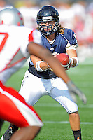 9 October 2010:  FIU quarterback Wesley Carroll (13) fakes a handoff in the second quarter as the FIU Golden Panthers defeated the Western Kentucky Hilltoppers, 28-21, at FIU Stadium in Miami, Florida.
