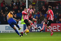 Lincoln City's Michael O'Connor blocks a shot from Mansfield Town's Jacob Mellis<br /> <br /> Photographer Andrew Vaughan/CameraSport<br /> <br /> The EFL Sky Bet League Two - Lincoln City v Mansfield Town - Saturday 24th November 2018 - Sincil Bank - Lincoln<br /> <br /> World Copyright &copy; 2018 CameraSport. All rights reserved. 43 Linden Ave. Countesthorpe. Leicester. England. LE8 5PG - Tel: +44 (0) 116 277 4147 - admin@camerasport.com - www.camerasport.com