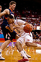 18 February 2012: Toney McCray #0 of the Nebraska Cornhuskers drive to the lane against Meyers Leonard #12 of the Fighting Illini during the second half at the Devaney Sports Center in Lincoln, Nebraska.  Nebraska defeated Illinois 80 to 57.