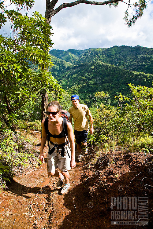 Caucasian couple hiking in Aiea