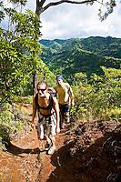Caucasian couple hiking in Aiea