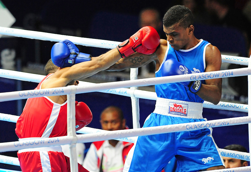 Seychelles' Andrique Allisop (blue) defeats Papua New Guinea's Tom Boga (red) in their men's light (62kg) round of 32. <br /> <br /> Photographer Chris Vaughan/CameraSport<br /> <br /> 20th Commonwealth Games - Day 3 - Saturday 26th July 2014 - Boxing - SECC - Glasgow - UK<br /> <br /> &copy; CameraSport - 43 Linden Ave. Countesthorpe. Leicester. England. LE8 5PG - Tel: +44 (0) 116 277 4147 - admin@camerasport.com - www.camerasport.com