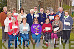 Finola Geary presents cheques to numerous charities at the Mad hatters tea party in the Organic Store Milltown on Saturday front row l-r: Mary Corkery, Sheila O'Sullivan, Finola Geary, Mary O'Riordan, Lorna Tyther. Back row: Louis Collier, Marion Geary, Wilma Silvius, Catherine Treacy, Ann McDade, Neill Farwell, Harry McDade, Kay Wrenn, Rose Clifford, John Griffin and Anita Galvin