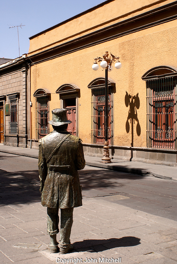 Bronze statue and Spanish colonial architecture in the city of San Luis de Potosi, Mexico