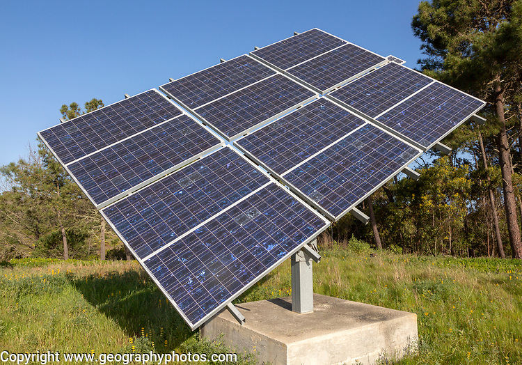 Solar panel array in rural location of field in countryside providing domestic energy near village of  Rogil, Algarve district, Portugal, southern Europe