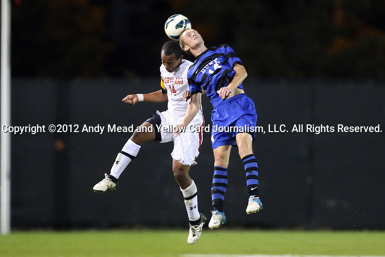 12 October 2012: Maryland's Jordan Cyrus (left) and Duke's Ryan Thompson (right) challenge for a header. The University of Maryland Terrapins defeated the Duke University Blue Devils 2-1 at Koskinen Stadium in Durham, North Carolina in a 2012 NCAA Division I Men's Soccer game.