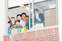 Schoolchildren look out of Graham & Parks School as Democratic presidential candidate and Massachusetts senator Elizabeth Warren arrives to vote in the Massachusetts primary as part of Super Tuesday voting in Cambridge, Massachusetts, on Tue., March 3, 2020. The polling place is just a few blocks from Warren's residence. Polls show Warren and Vermont senator Bernie Sanders in a near tie in the Massachusetts Democratic party primary.
