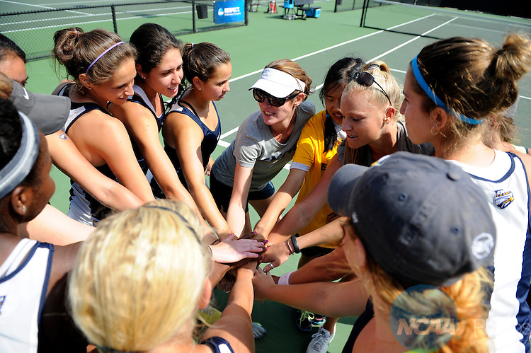 21 MAY 2014:  The Emory University tennis team huddles before the Division III Women's Tennis Championship held at the Biszantz Family Tennis Center in Claremont, CA.  Emory defeated Amherst 5-1 to win the national title.  Justin Tafoya/NCAA Photos