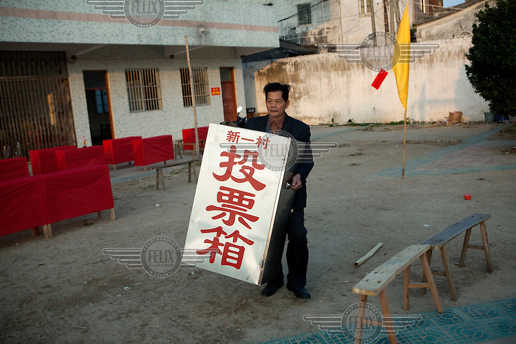 Workers prepare ballot boxes at a polling station in Wukan. Wukan villagers are preparing to vote for election organisers on February 1 following the unrest in the village in December 2011 when the villagers drove out corrupt communist party officials.