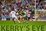 Paul Galvin,Kerry in action against Emmet Bolton, Kildare in the All Ireland Quarter Final at Croke Park on Sunday.