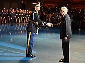 Outgoing United States Secretary of Defense Chuck Hagel (R) shakes hands with a member of the Honor Guard during an Armed Forces Farewell Tribute, January 28, 2015 at Joint Base Myer-Henderson Hall, Virginia. Deputy Secretary Ashton Carter, who has served under Leon Panetta and Hagel is expected to be easily approved by the Senate to succeed Hagel.<br /> Credit: Mike Theiler / Pool via CNP