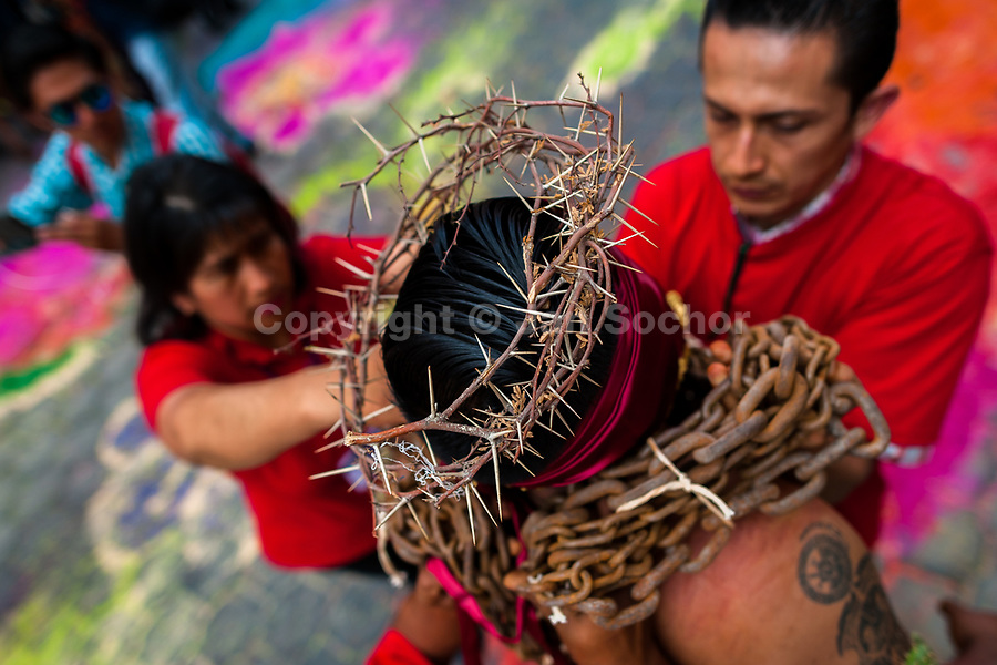 A chained Catholic penitent, wearing a crown of thorns, is seen while receiving relief support during the Holy week procession in Atlixco, Mexico, 30 March 2018. Every year on Good Friday, dozens of anonymous men of all ages voluntarily undergo pain and suffering during the religious procession of the 'Engrillados' (the Shackled ones) in Puebla state, central Mexico. Wearing heavy chains on their shoulders covered with prickling cacti while being burned by the hot midday sun, they recall Jesus Christ's death by crucifixion and demonstrate their religiosity and faith.