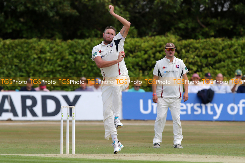 Mitch Claydon in bowling action for  Kent CCC