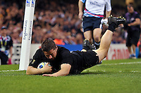 Dane Coles of New Zealand dives for the try-line. Rugby World Cup Pool C match between New Zealand and Georgia on October 2, 2015 at the Millennium Stadium in Cardiff, Wales. Photo by: Patrick Khachfe / Onside Images