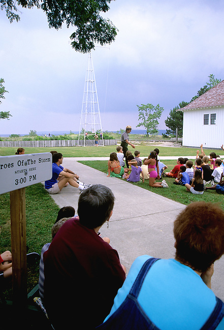 Children watch a ranger demonstration of Breeches Buoy Life Saving at the old Coast Guard Life Saving Station and Museum at Sleeping Bear Dunes National Lakeshore in Leelanau County, Michigan