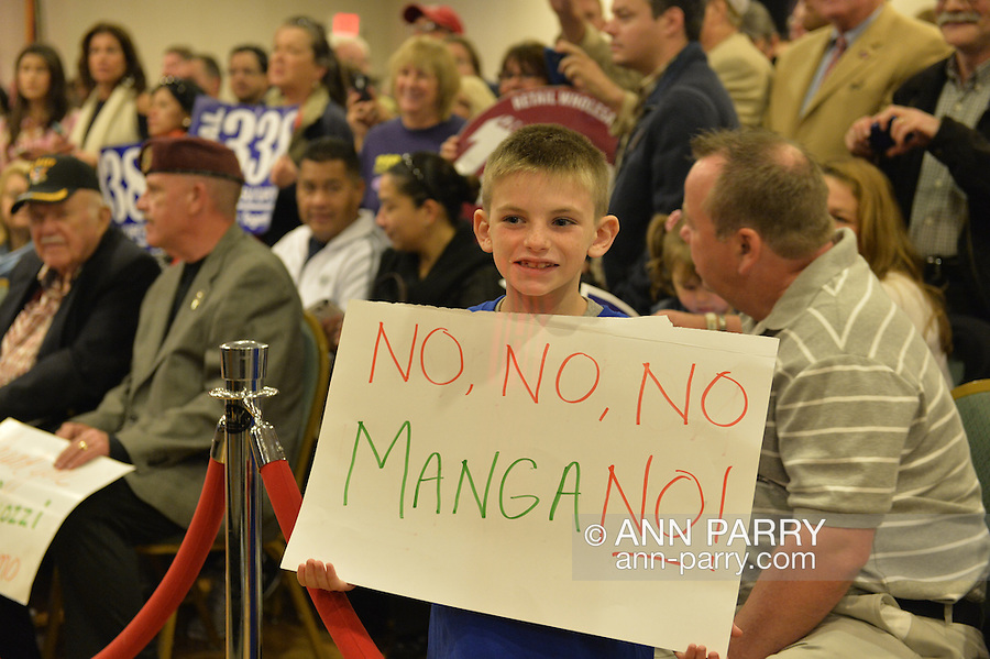 Albertson, New York, U.S. 26th October 2013. FINNEGAN CORCORAN-DOOLIN, 8, of Bellmore, is holding a poster in the audience when New York Governor Cuomo endorses Suozzi for Nassau County Executive, at the Albertson Veterans of Foreign Wars VFW Post. Democrat Suozzi, the former Nassau County Executive, and Republican incumbent Mangano face each other in a rematch in the upcoming November 5th election.