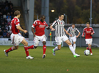 Kenny McLean holds off Isaac Osbourne in the St Mirren v Aberdeen Clydesdale Bank Scottish Premier League match played at St Mirren Park, Paisley on 9.11.12.