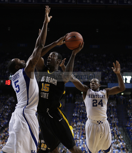 University of Kentucky senior guard Ramon Harris and University of Kentucky freshman guard Eric Bledsoe attempt to guard Long Beach State forward T.J. Robinson in UK's 86-73 win in Rupp Arena on Wednesday, Dec., 23, 2009. ..Photo by Ed Matthews | Staff
