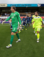 The players enter the field with Goalkeeper Sam Walker of Colchester United during the Sky Bet League 2 match between Wycombe Wanderers and Colchester United at Adams Park, High Wycombe, England on 27 August 2016. Photo by Liam McAvoy.