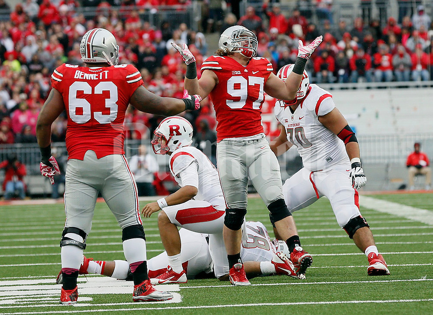 Ohio State Buckeyes defensive lineman Joey Bosa (97) celebrates his tackle in the second quarter of their game at Ohio Stadium in Columbus, Ohio on October 18, 2014. (Columbus Dispatch photo by Brooke LaValley)