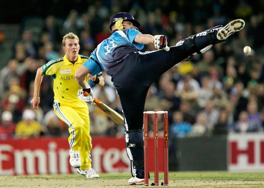 England batsman Andrew Flintoff kicks out at a ball from Australian bowler Brett Lee
