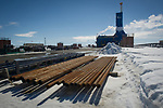 Driliing pipe is stacked outside Parker Drilling rig 272 on the Arctic plain of Prudhoe Bay.