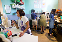 NWA Democrat-Gazette/JASON IVESTER<br /> Margarita Fontana helps a customer Thursday, May 25, 2017, during an open house for Anime Cafe in downtown Rogers.