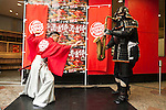 (L to R) Aka Samurai and Kuro Shogun perform during the new Burger King's red burgers launching event on July 3, 2015, in Tokyo, Japan. The two new burgers ''AKA SAMURAI CHICKEN'' and ''AKA SAMURAI BEEF'' use red buns and red cheese, colored by tomato powder and spicy red sauce and will be sold at Japanese branches until August. The AKA SAMURAI CHICKEN costs 540 JPY (4.39 USD) and the AKA SAMURAI BEEF costs at 690 JPY (5.61 USD). As a part of the promotion Burger King plans to launch two new black burgers on August 21st. (Photo by Rodrigo Reyes Marin/AFLO)