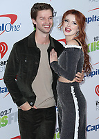 LOS ANGELES- DECEMBER 1:  Patrick Schwarzenegger and Bella Thorne at the 102.7 KIIS FM's Jingle Ball 2017 at the Forum on December 1, 2017 in Los Angeles, California. (Photo by Scott Kirkland/PictureGroup)